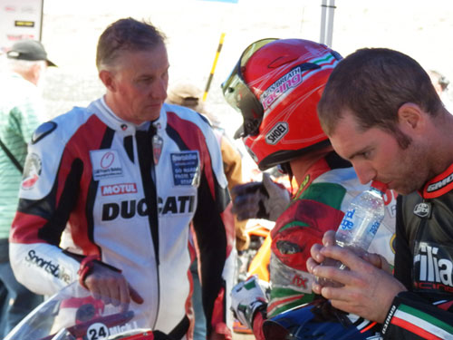 P.Martin Ducati 1198s with Mick Johnston in after race discussion.